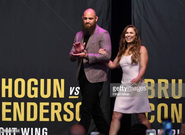 Mixed martial artist Travis Browne walks onstage with his wife Ronda Rousey as she becomes the first female inducted into the UFC Hall of Fame at The...