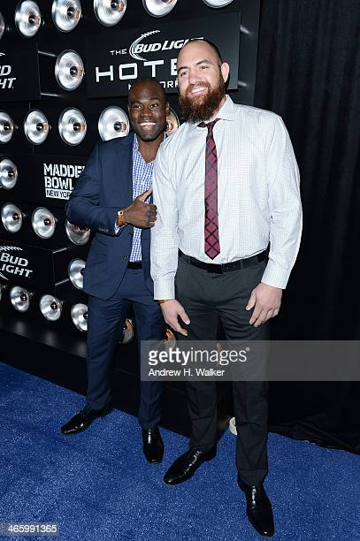 Mixed martial artist Uriah Hall and professional football player Travis Brown attend the Bud Light Madden Bowl at The Bud Light Hotel on January 30...