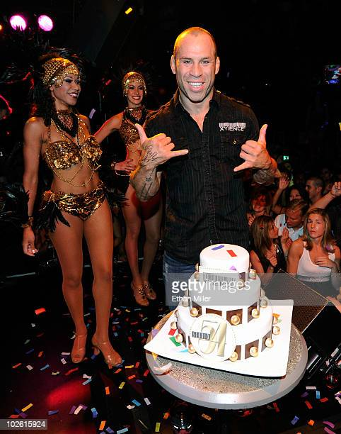Mixed martial artist Wanderlei Silva is presented with a cake at his 34th birthday celebration and postfight party for UFC 116 at Studio 54 inside...