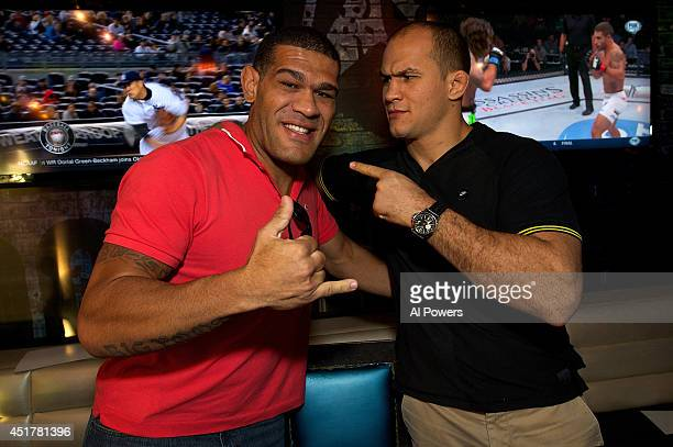 Mixed martial artists Antonio 'Bigfoot' Silva and Junior Dos Santos pose at the UFC Brazilian party during UFC International Fight Week inside the...