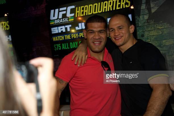 Mixed martial artists Antonio 'Bigfoot' Silva and Junior Dos Santos pose at the UFC Brazilian party during UFC International Fight Week inside the...