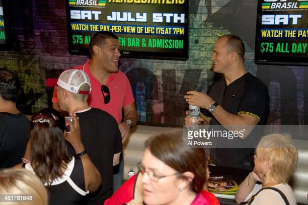 Mixed martial artists Antonio 'Bigfoot' Silva and Junior Dos Santos interact at the UFC Brazilian party during UFC International Fight Week inside...