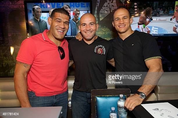 Mixed martial artists Antonio 'Bigfoot' Silva Glover Texeira and Junior Dos Santos pose at the UFC Brazilian party during UFC International Fight...