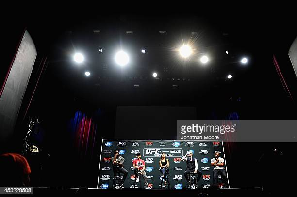 Mixed martial artists Jon Jones Dustin Poirier commentator Megan Olivi Mixed martial artists Conor McGregor of Ireland and Daniel Cormier talk at LA...