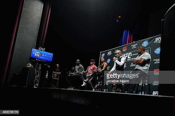 Mixed martial artists Jon Jones Dustin Poirier commentator Megan Olivi Mixed martial artists Conor McGregor of Ireland and Daniel Cormier talk during...