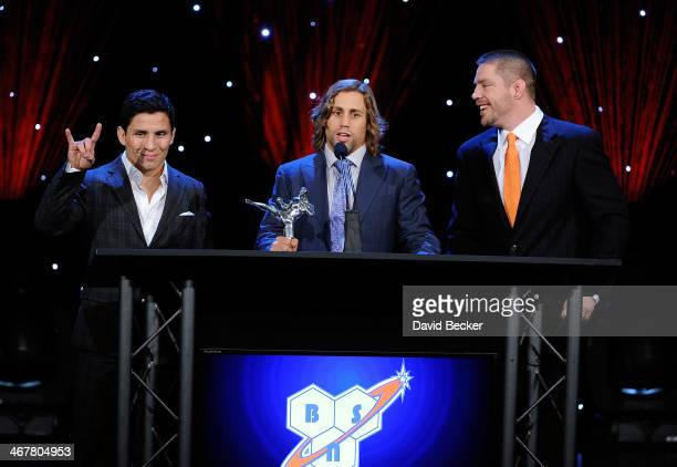 Mixed martial artists Joseph Benavidez Urijah Faber and coach and former mixed martial artist Duane Ludwig accept the Gym of the Year award during...