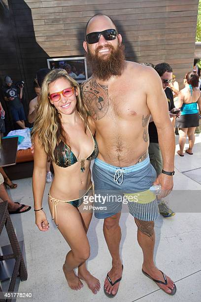 Mixed martial artists Miesha Tate and Travis Browne arrives at the UFC pool party during UFC International Fight Week at the Liquid Pool Lounge at...