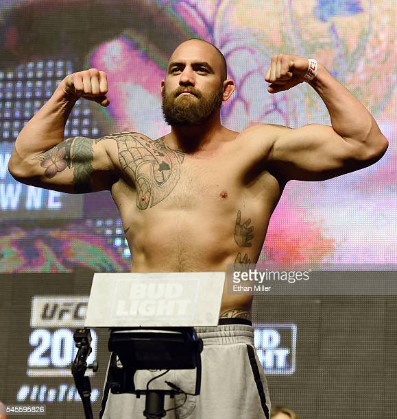Mixed martial artists Travis Browne poses on the scale during his weighin for UFC 200 at TMobile Arena on July 8 2016 in Las Vegas Nevada Browne will...