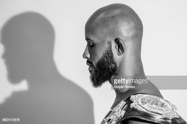 Closeup portrait of UFC Flyweight champion Demetrious Johnson posing with belt during photo shoot at Time Inc Studios Johnson has succesfully...