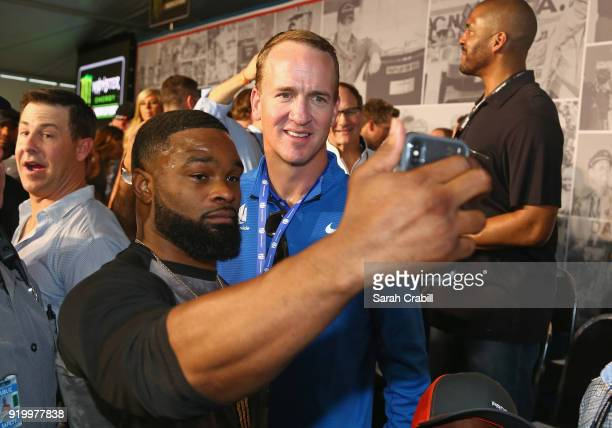 Mixed martial arts fighter and actor Tyron Woodley takes a selfie with twotime Super Bowl winning quarterback Peyton Manning during the drivers...
