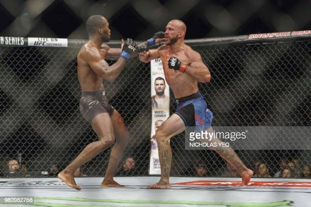 UFC mixed martial arts fighter Donald 'Cowboy' Cerrone of the US fights against Leon 'Rocky' Edwards of Britain during the UFC Fight night in...