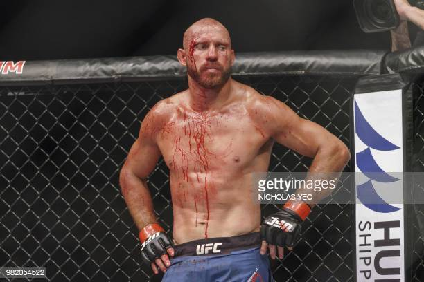 Mixed martial arts fighter Donald 'Cowboy' Cerrone of the US looks on after a fight against Leon 'Rocky' Edwards of Britain during the UFC Fight...