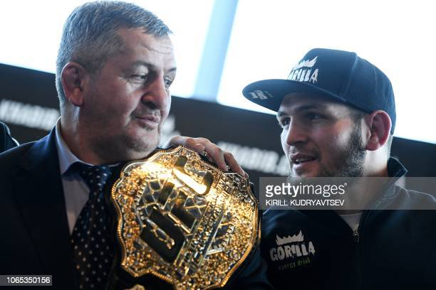 Mixed martial arts fighter Khabib Nurmagomedov and and his father Abdulmanap Nurmagomedov give a press conference in Moscow on November 26 2018