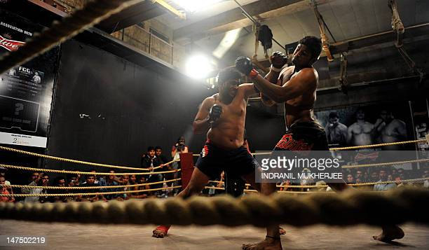 Mixed Martial Arts fighter Nitin Gaikwad punches opponent Alfan Hashmi during a bout at the FCC 6 fight night in Mumbai on June 30, 2012. Fight...