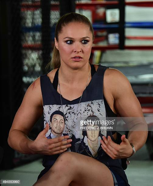 Mixed Martial Arts fighter Ronda Rousey wearing a shirt with portraits of former heavyweight boxing champion Muhammad Ali and the late US singer...