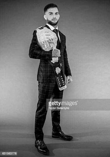 Portrait of UFC Bantamweight champion Cody Garbrandt posing with belt during photo shoot at Time Inc Studios New York NY CREDIT Taylor Ballantyne
