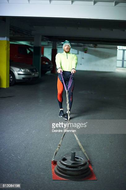 Portrait of UFC Featherweight champion Conor McGregor pulling weights during workout session at ISI Personal Training Centre Behind the Scenes Dublin...