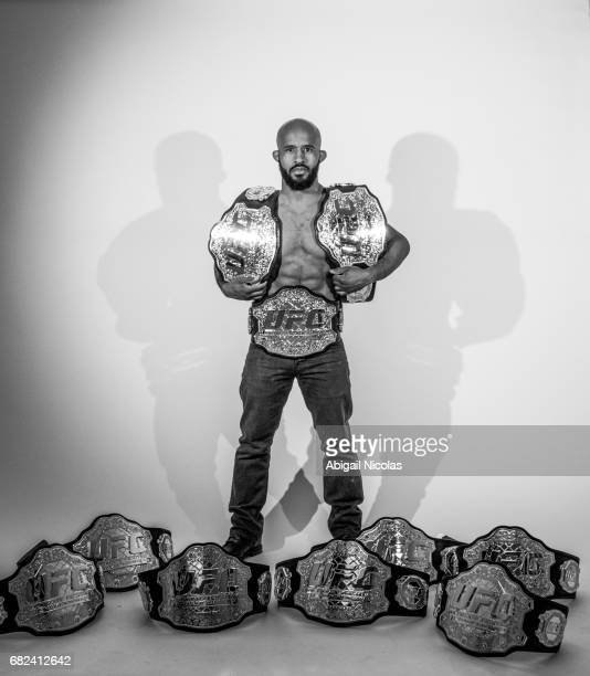 Portrait of UFC Flyweight champion Demetrious Johnson posing with 10 belts during photo shoot at Time Inc Studios Johnson has succesfully defended...