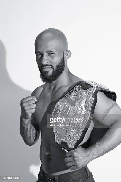 Portrait of UFC Flyweight champion Demetrious Johnson posing with belt during photo shoot at Time Inc Studios Johnson has succesfully defended his...