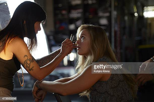 Portrait of UFC Women's Bantamweight champion Ronda Rousey having makeup applied before photo shoot at Muscle Beach in Venice Behind the Scenes Los...