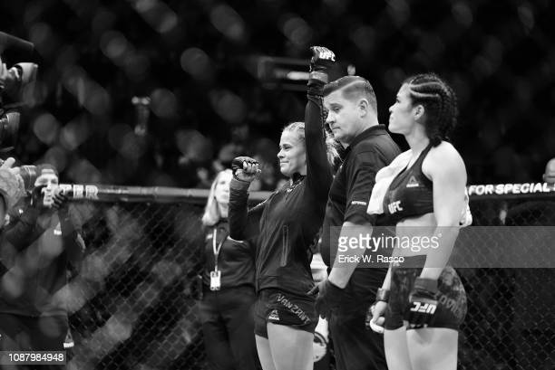 UFC 143 Rachael Ostovich victorious with arm raised after Women Flyweight bout vs Paige VanZant at Barclays Center Brooklyn NY CREDIT Erick W Rasco