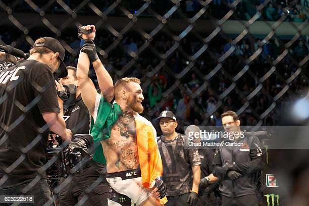 Conor McGregor victorious wearing belt and Irish flag after winning Men's Lightweight fight vs Eddie Alvarez at Madison Square Garden. New York, NY...