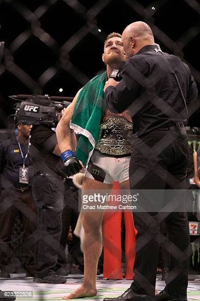 UFC 205 Conor McGregor victorious wearing belt and Irish flag after winning Men's Lightweight fight vs Eddie Alvarez at Madison Square Garden New...