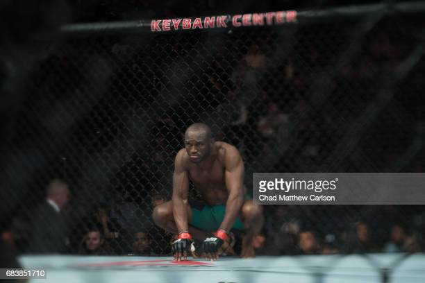 UFC 210 Kamaru Usman squating on the mat during Welterweight class fight vs Sean Strickland at KeyBank Center Buffalo NY CREDIT Chad Matthew Carlson