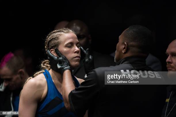 UFC 210 Katlyn Chookagian being treated by her corner during fight vs Irene Aldana at KeyBank Center Chookagian defeated Aldana by split decision...