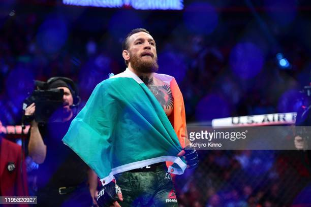 Fight Night 246: Connor McGregor victorious, wearing Ireland flag after knocking out Donald Cerrone during Welterweight match at T-Mobile Arena. Las...