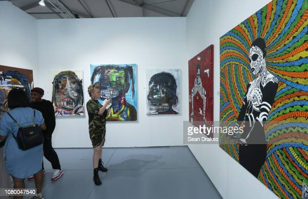 Mixed media collages by Genesis Tramaine and paintings by Laolu Senbanjo at Scope Art Fair as part of the 2018 Art Basel Miami Beach on December 8...