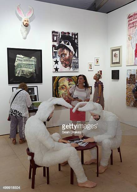 Mixed media installation by Alex Podesta and paintings by Gregory St Amand in the Untitled Projects Gallery at Scope art fair during Art Basel Miami...