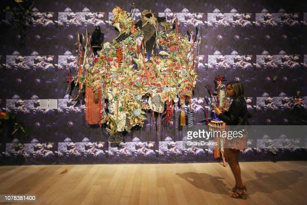 Mixed media installation by Jamaican artist Ebony G Patterson titled 'while the dew is still on the roses' presented as part of the 2018 Art Basel...