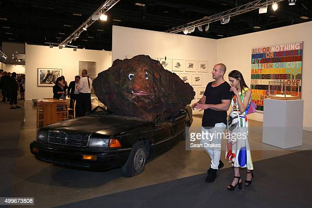 A mixed media installation by Jimmie Durham in the Peter Freeman Gallery on display during Art Basel Miami Beach at the Miami Convention Center in...