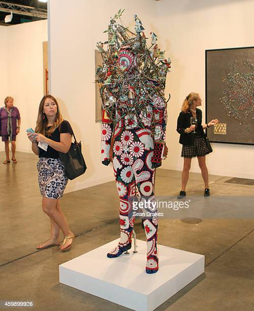Mixed media sculpture titled Soundsuit by Nick Cave is shown during the Art Basel Miami Beach at Jack Shainman Gallery on December 03 2014 in Miami...