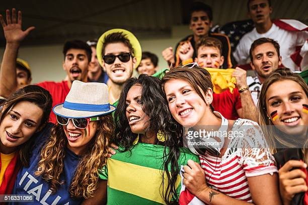 mixed national world supporter at the soccer stadium