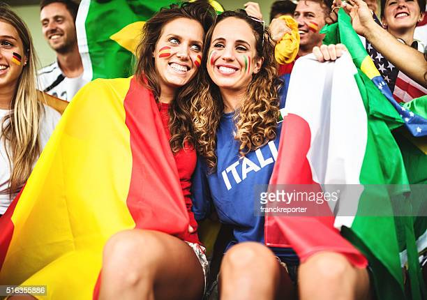 mixed national world supporter at the soccer stadium - rivaliteit stockfoto's en -beelden