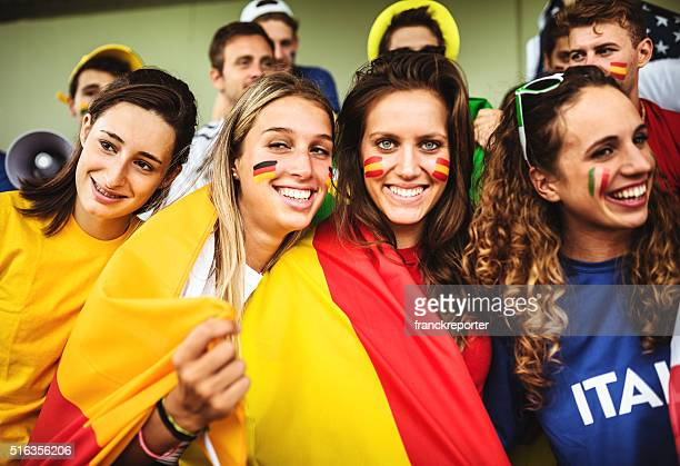 mixed national world supporter at the soccer stadium - football body paint stock photos and pictures