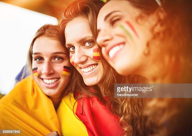 mixed national world supporter at the soccer stadium - sports team event stock photos and pictures