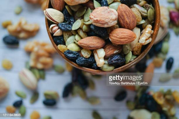 mixed nut in a bowl - ナッツ類 ストックフォトと画像