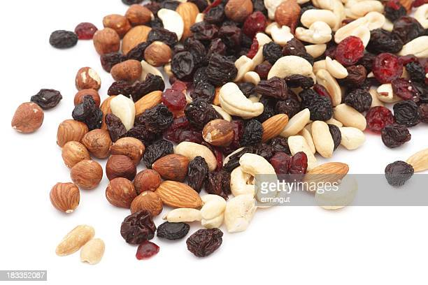 Mixed nuts and dry fruits over white background