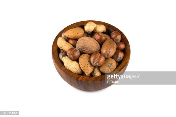 mixed nuts in shells in a bowl a white background - brazil nut fotografías e imágenes de stock