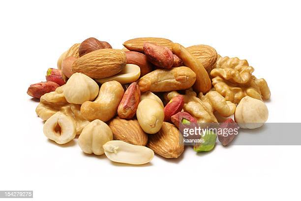 mixed nuts - peanuts stockfoto's en -beelden