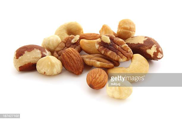 mixed nuts - walnut stock pictures, royalty-free photos & images