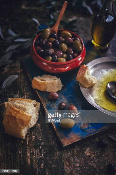 mixed olives and extra virgin olive oil - kalamata olive stock photos and pictures
