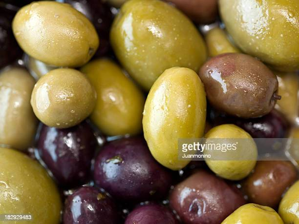 mixed olives background - antipasto stock pictures, royalty-free photos & images