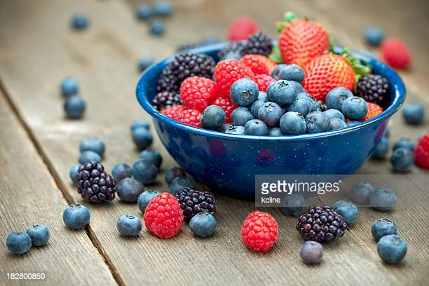 mixed organic berries - blackberry fruit stock pictures, royalty-free photos & images