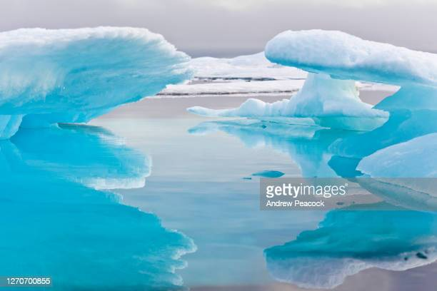 mixed pack ice in barrow strait, qikiqtaaluk region, nunavut, canada. - pack ice stock pictures, royalty-free photos & images
