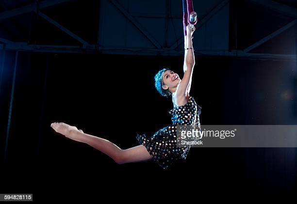 Mixed race acrobat performing