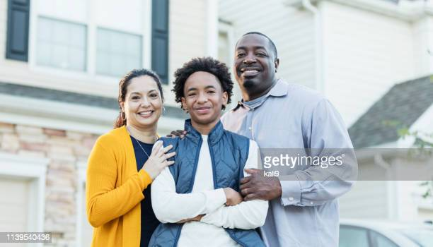 mixed race african-american and hispanic family - family with one child stock pictures, royalty-free photos & images